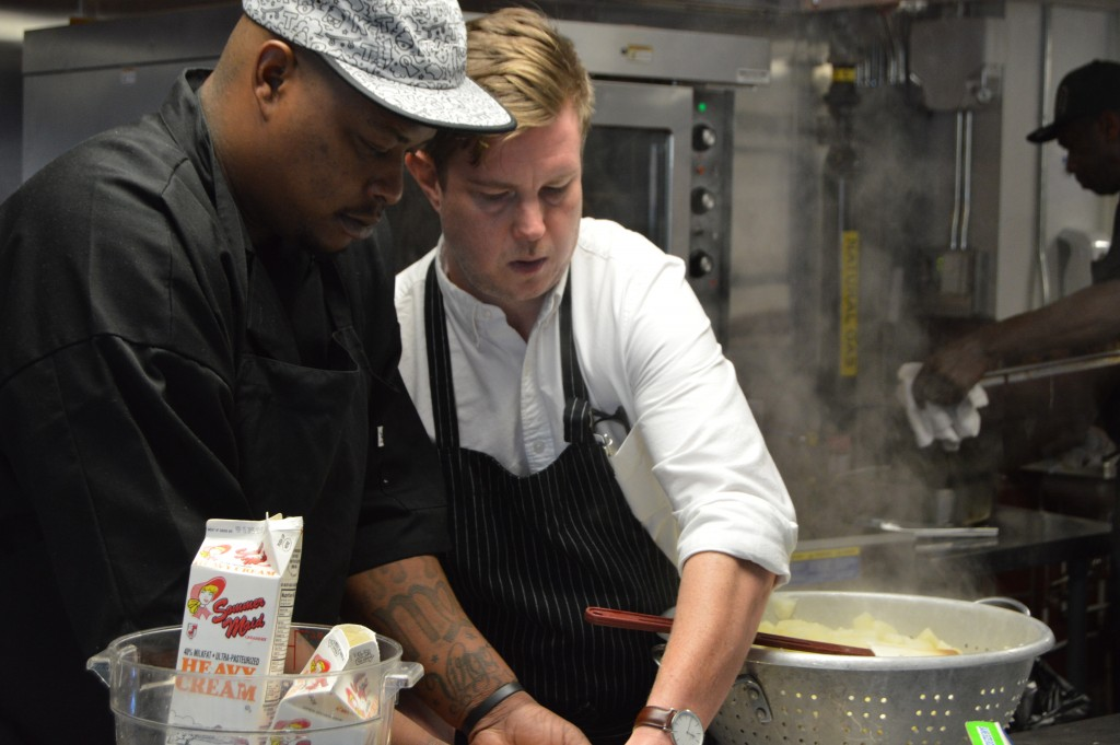 Chef Dawes works with a Kitchen Ready student.